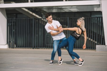 Photo for Young couple of contemporary dancers practicing on urban city street - Royalty Free Image
