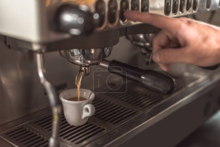 cropped shot of barista preparing coffee with coffee machine in restaurant