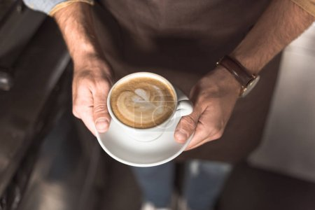 Photo for Cropped shot of barista holding cup of fresh made cappuccino - Royalty Free Image