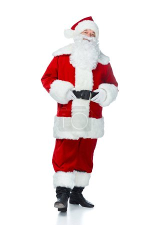 happy santa claus posing in red costume isolated on white