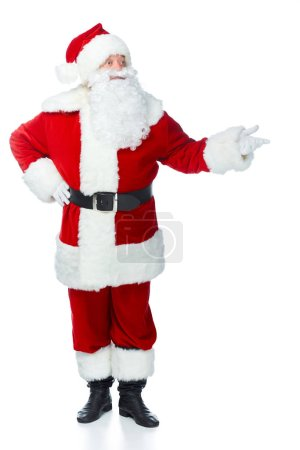 santa claus in red costume presenting something isolated on white