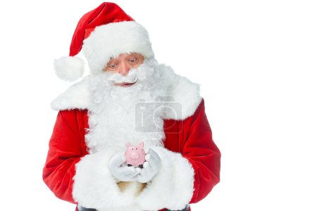 santa claus holding little piggy bank isolated on white