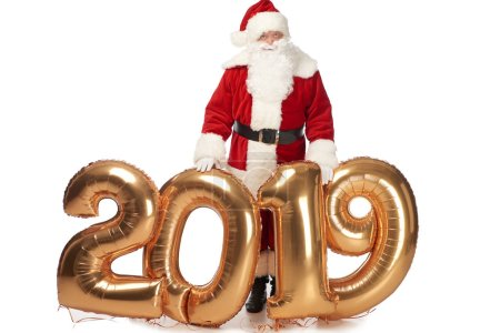 santa claus posing with new year 2019 golden balloons isolated on white