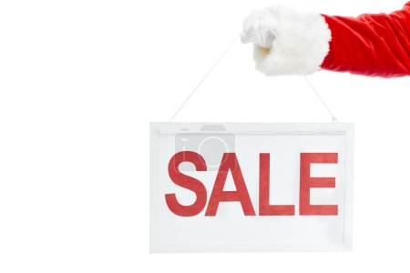 cropped view of santa claus holding sale board isolated on white