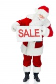 santa claus in red costume holding sale board isolated on white