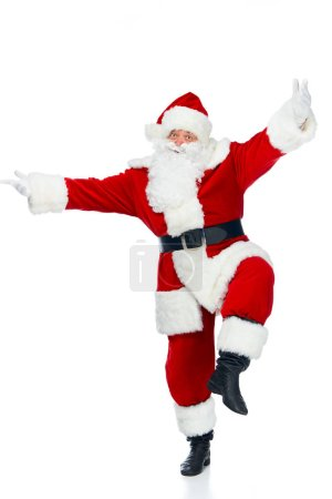 Photo for Funny bearded santa claus jumping isolated on white - Royalty Free Image