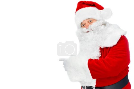 Photo for Bearded santa claus pointing at something isolated on white - Royalty Free Image