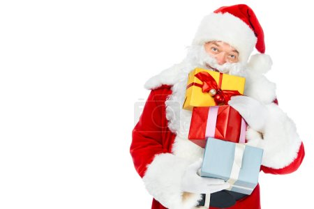 Photo for Santa claus in red costume with christmas gift boxes isolated on white - Royalty Free Image