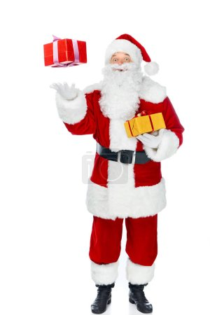 santa claus with christmas gift boxes isolated on white