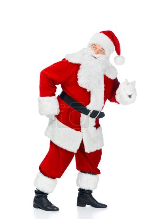 Photo for Funny santa claus walking in red costume isolated on white - Royalty Free Image