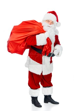 Photo for Santa claus in red costume carrying christmas bag isolated on white - Royalty Free Image