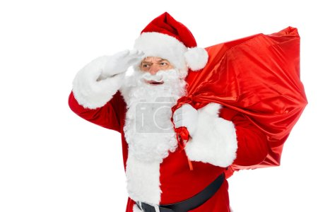 Photo for Santa claus in red hat holding christmas bag and looking away isolated on white - Royalty Free Image