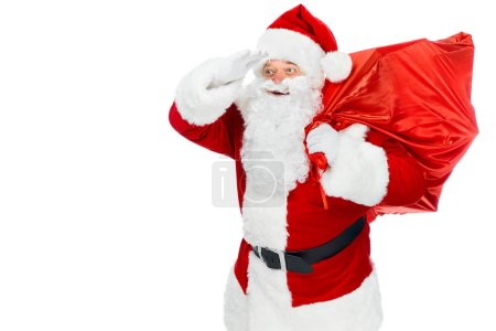 bearded santa claus with red christmas bag looking away isolated on white