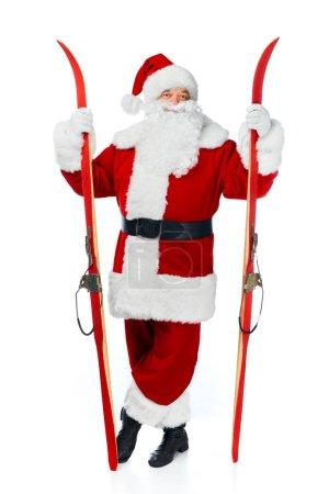 santa claus holding skis isolated on white