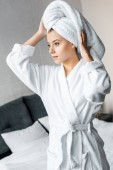attractive girl in white bathrobe wearing towel on head