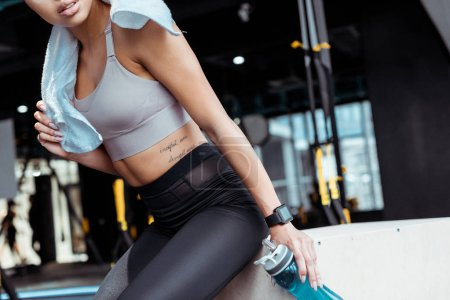 Partial view of attractive sportive girl in fitness gym
