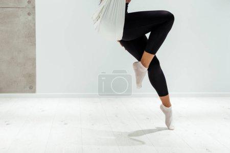 Partial view of female doing antigravity yoga in studio