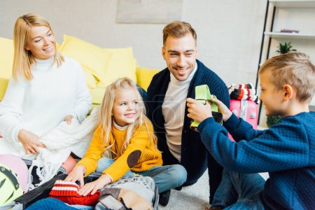 happy family having great time and packing for winter holidays