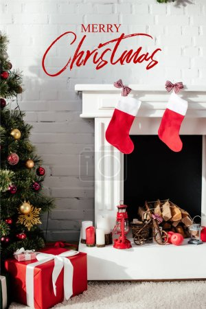 "christmas tree with bubbles, gift boxes and fireplace with christmas stockings at home with ""merry christmas"" lettering"