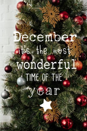 """christmas tree with balls and golden snowflakes with """"December it is the most wonderful time of the year"""" lettering"""