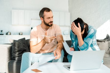 husband and wife using laptop and having financial problems at home