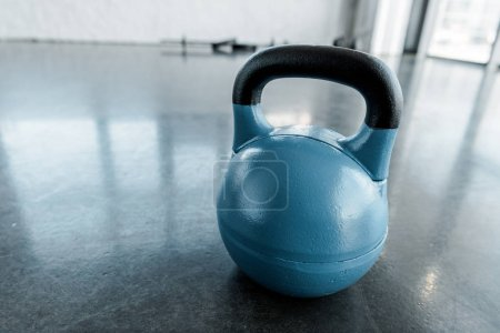 Photo for Large blue kettlebell on gym floor with copy space - Royalty Free Image