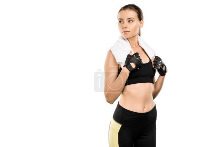 serious sportswoman in weightlifting gloves with white towel isolated on white