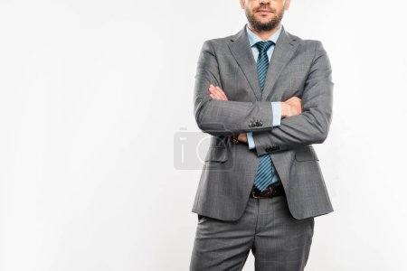 Photo for Cropped shot of confident businessman standing with crossed arms isolated on white - Royalty Free Image
