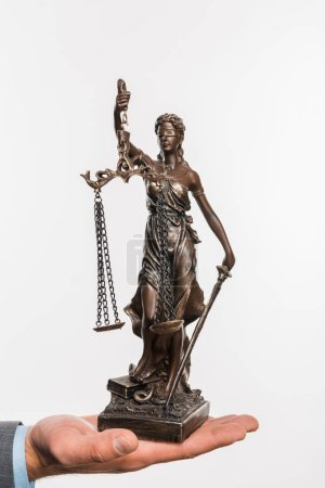 close-up partial view of businessman holding lady justice statue isolated on white