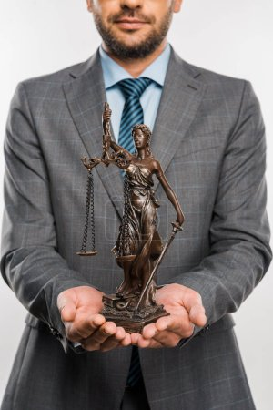 cropped shot of lawyer holding lady justice statue isolated on white