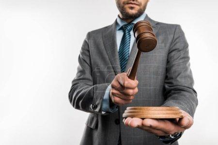 Photo pour Vue à angle bas du juge tenant le marteau en bois isolé sur blanc - image libre de droit