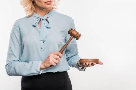 cropped shot of female judge holding hammer isolated on white