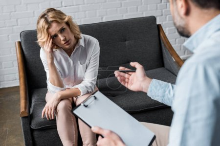 sad woman on psychologist therapy session at office