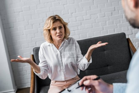 confused woman on psychologist therapy session at office