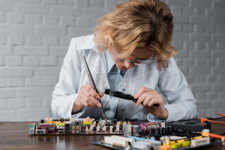 concentrated female computer engineer repairing motherboard