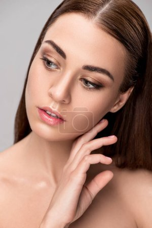 portrait of beautiful tender girl with perfect clean face, isolated on grey