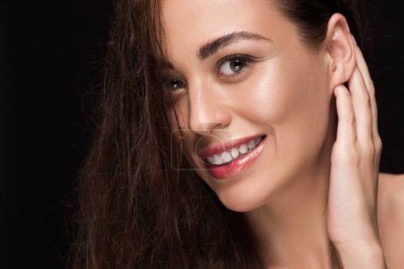 portrait of beautiful smiling girl with brunette hair, isolated on black