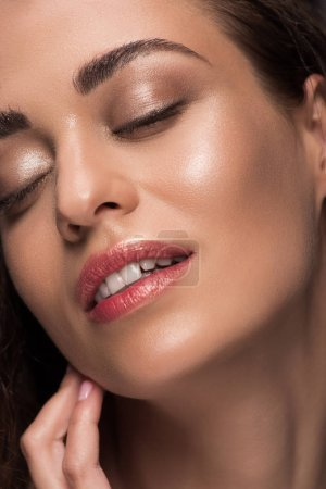 close up of beautiful tender young woman with skin care and closed eyes