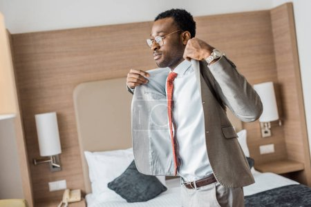 handsome african american businessman wearing gray jacket