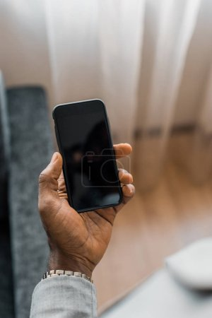 cropped view of african american man using smartphone with blank screen