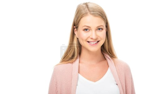 beautiful woman in pink cardigan smiling and looking at camera isolated on white