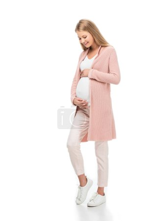 Photo for Full length of pregnant beautiful pregnant woman touching belly isolated on white - Royalty Free Image