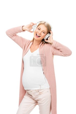 happy pregnant woman dancing with headphones isolated on white
