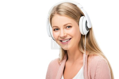 Photo for Smiling woman listening music, using headphones and looking at camera isolated on white - Royalty Free Image