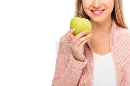 Photo for Cropped view of beautiful woman smiling and holding apple isolated on white - Royalty Free Image