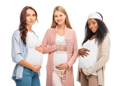 multiethnic pregnant women standing together isolated on white