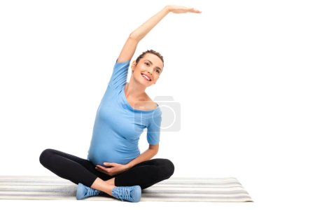 pregnant brown haired woman stretching and smiling isolated on white