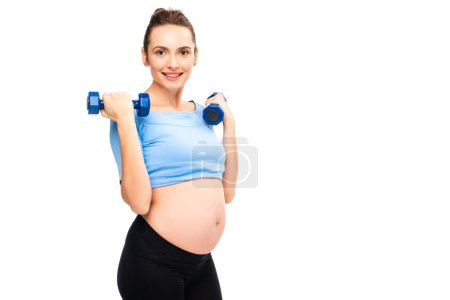 pregnant woman holding dumbbells near shoulders isolated on white