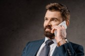 close up of bearded businessman talking on smartphone