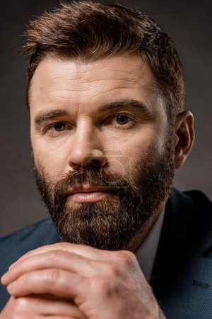 Photo for Close up of confident bearded man with praying hands - Royalty Free Image